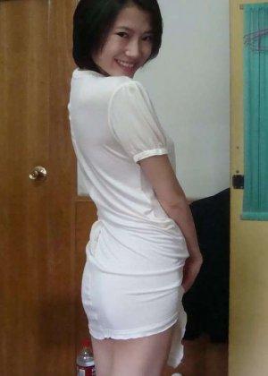 Грудастая азиатка в белом белье хвастается большими дойками - фото 7