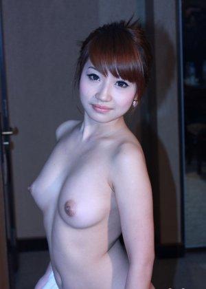 Эротика красивой азиатки - фото 12